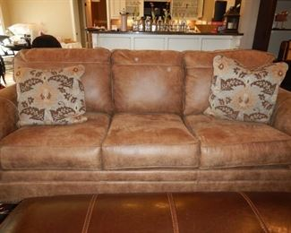 Ashley furniture 3 seat sofa with two cushions, suede like upholstery