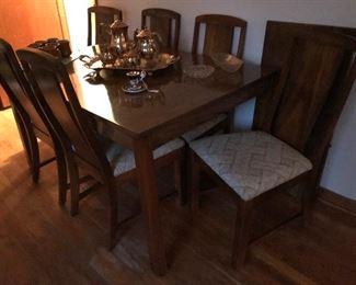MCM dining table an extension leaf with 6 chairs (1 captains chair)