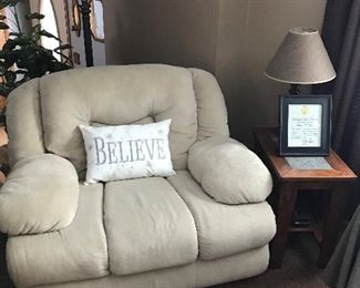 One of three piece living room set with matching end tables and lamps. This piece is also a recliner