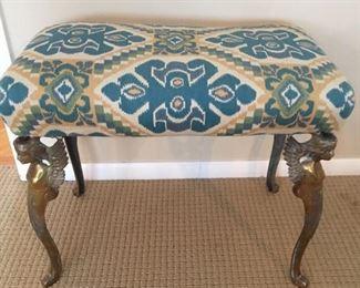 Decorative stool with brass angel figurines