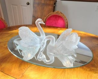 Lalique swans on mirror base.