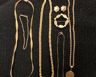 Gold jewelry; Coin is 1925-D US $2.50 piece. It can be sold separately from the chain.