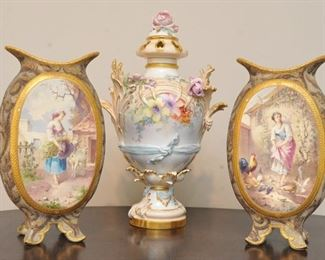 French Coraline vases on either side of a KPM covered urn.