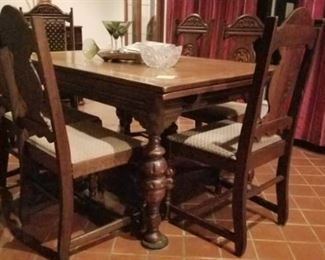 Antique oak drawleaf dining table with 6 chairs