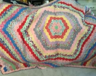 Beautiful handmade quilts! I believe this pattern is Around the World