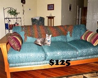 Oak Mission style green couch (cat not included)