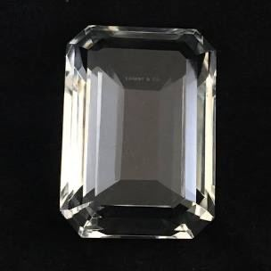 Touch of glamour from Tiffany & Co., this cut crystal paperweight design is the shape of a traditional emerald. No chips. It's 3″w x 4″d x 2″h.  $95