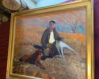 """An oil painting scene of hunter and two dogs by listed American artist Howard Buck (20th Century), created in the 40's. Portrayed with loose expressionistic brushstrokes and vibrant colors. The painting is signed to the lower right. It is presented in a bronze-tone gesso frame with an abstract decorative pattern and a gold-tone edge. approximately 29.5"""" W x 23.5"""" H.  $100"""