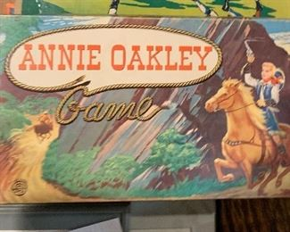 """Rare 1950s Annie Oakley Board Game by Milton Bradley - Touted as a """"real Wild West"""" game, up to four players, the object of the board game is to capture as many outlaws as one can. Like new. $30"""