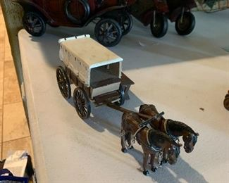 Berkeley vintage model T or A and 2 motor cycles. EX condition  Cast Iron Stagecoach, unmarked, great condition.