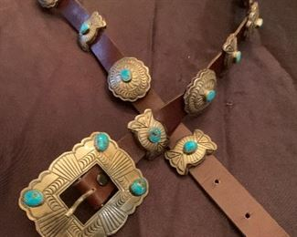 """Silver and turquoise Mexican Concho belt. Mounted on 36"""" brown leather belt with 9 conchos, and 9 smaller pieces with  buckle.  $600"""