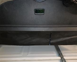 Infiniti QX 56 rear hatch divider and cargo nets.