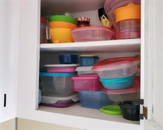 cabinets are packed, with misc and tupperware