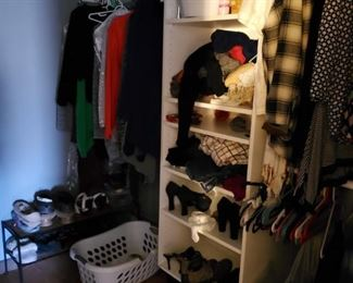 closet packed with mens and womens clothing