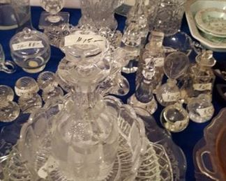 Pressed and cut glass plates, perfume bottles, etc.