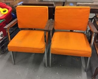 mid mod office chairs with orange upholstery
