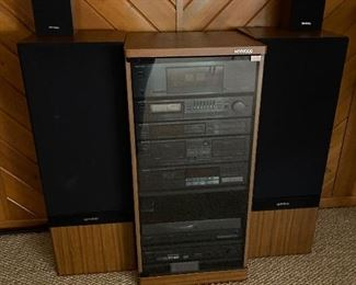 Kenwood stereo system & cabinet; Kenwood speakers.  Pricing for individual components add up to $630.  Will sell complete system for $500.  Here are the listed components:  JL1080AV Speakers $200; LSK-01S Bookshelf speakers $15; Power Amplifier KM-208 $90; Stereo Control Amp KC206 $80; Quartz Synthesizer Stereo Tuner KT-58 $25; AV Surround Processor $35; Disc Player DP-M98 $40; Dual Cassette Deck $25; Tuner KT88 $20; Turntable KD-45F  $75; Cabinet $25