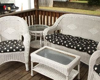 Grouping of wicker on porch.