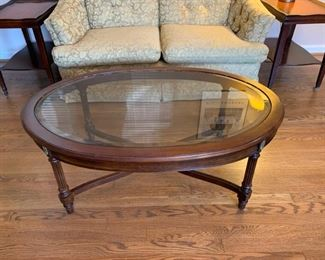 "#1	 Oval coffee table with wood base and glass top 44""x31""x17""	 $40.00"
