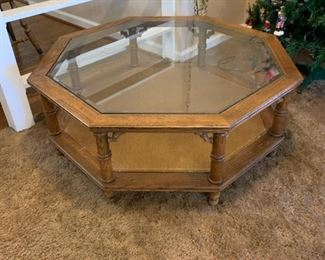 "#8	Octagonal coffee table  with wood base and beveled glass top 38""x13""	 $40.00"