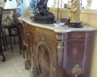 French 1890s style piece with marble top and marquetry inlay work.