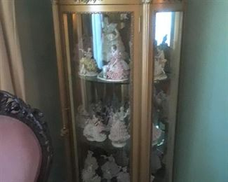 New French style display filled with 1980s era Dresden figurines with lace and tulle. All in excellent condition.