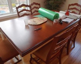 Another kitchen table with 6 chairs and two leafs.