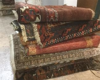 Dozens of Persian and Turkish rugs