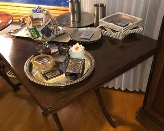 Folding mahogany card table with stainless steel appetizer and crudités sets, along with vintage pipes, ashtrays and lighters