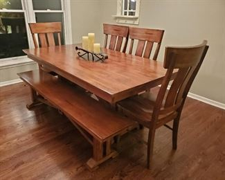 Lovely dining room set with 4 chairs and a bench to match