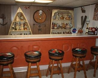 The shelves in back are an actual row boat turned into display shelves.  5 JC Penny mid century wine barrel bar stools.