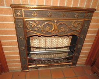 Ornate bronze fireplace heater & surround