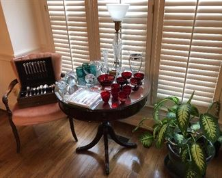1881 ROgers flatware, Crystal lamp, roud mahogany table