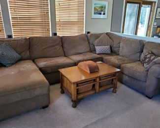 Very large brown sectional. Coffee table with wicker storage baskets