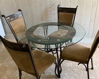 Glass and iron table and 4 chairs