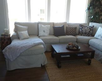 Sectional with chaise, end table and lamp, and rustic industrial style coffee table on castors!