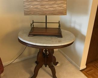 Antique marble top table and fun lamp