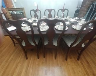 Hitchcock table with two leaves and 8 chairs two having arms