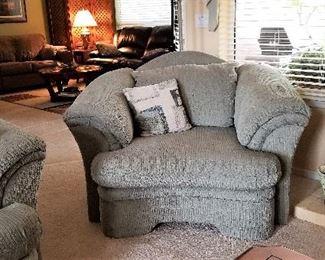 Gray fabric overstuffed chair
