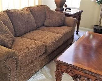 Great fabric sofa with neutral color and wonderful coffee table.