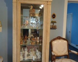 Display Cabinet filled with Lenox, Crystal and Anri Figurines