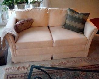 Custom upholstered love seat.