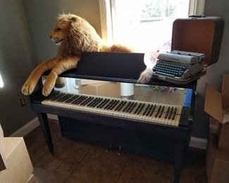 upright piano and vintage typewriter