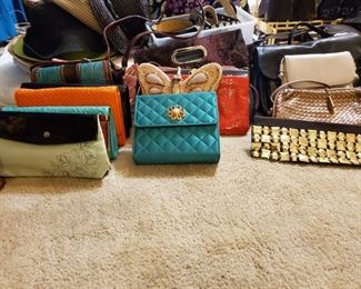 This woman had more purses than Costco has those sample Ladies.  I love those ladies though.  Free Lunch on Saturdays.  Go there after my sale.  Then come back and spend all of the money you saved.  CoCo, Michael Kors, Chico's, Louis Vuitton, etc.