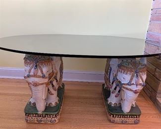 Fun Elephant statues holding up a tempered piece of glass to make an awesome accent tables (elephants are as-is and have some minor imperfections) But are still super fun!