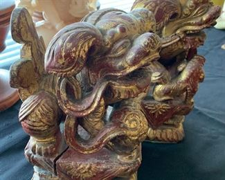 Pair of wood carved Chinese foo dogs with applied gold leaf