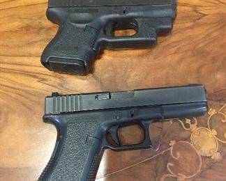 Small:  Glock 26 Large: Glock 22