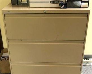 Triple file cabinet $30