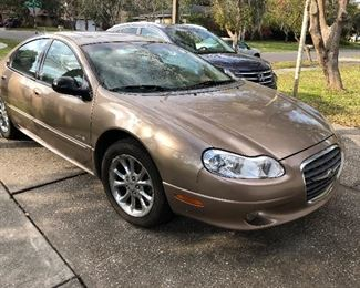 56,513 miles on this 1999 Chrysler LHS.  Clean and Cold!