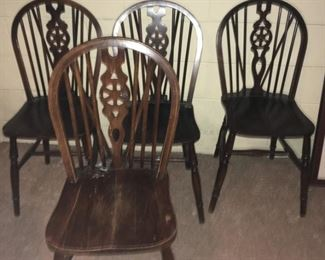 """. . . a wonderful set of """"wheel back"""" chairs imported from England."""